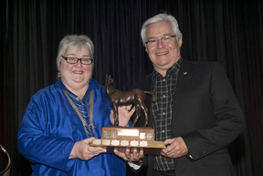 Jan Stephens, past member EC Board, past chair Stewards Committee, and accepting for Tanya Strasser Shostak, President, Federation Equestre du Quebec and EC Board member, Paul Cote. Photo by Shereen Jerrett